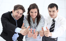 Successful business team showing thumbs up. Success concept: friendly business team Stock Photo