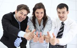 Successful business team showing thumbs up. Success concept: friendly business team Royalty Free Stock Photos