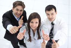 Successful business team showing thumbs up. Success concept: friendly business team Stock Photos