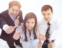 Successful business team showing thumbs up. Success concept: friendly business team Royalty Free Stock Photography