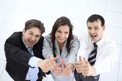 Successful business team showing thumbs up. Success concept: friendly business team Stock Photography