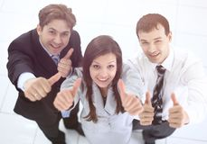Successful business team showing thumbs up royalty free stock images