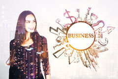 Success concept. Grogeous smiling girl on abstract light background with round business sketch and night city view. Success concept. Double exposure Royalty Free Stock Image