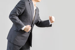 Success Concept Illustrated by Businessman in Rush Running Forward, Isolated on White Background. Studio shot of businessman in rush running forward, isolated on Royalty Free Stock Photography
