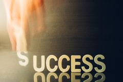 Success concept people holding S for fill word success Stock Photo