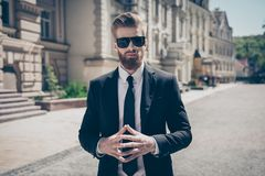 Success concept. Stylish elegant harsh bearded guy in a suit and. Sunglasses. So stylish and stunning! Outdoors royalty free stock image