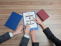 Success concept. Two businesspeople drawing success concept on paper royalty free stock photos