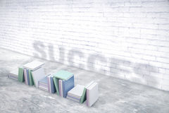 Success concept. White brick room with pile of books projecting success shadow. 3D Rendering Stock Photo