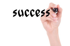 Success concept - woman hand holding marker and writing isolated Stock Image