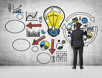 Success concept. Young businessman drawing success concept on wal Royalty Free Stock Images