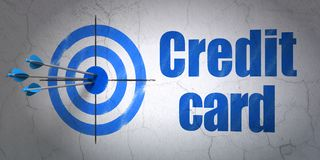 Currency concept: target and Credit Card on wall background. Success currency concept: arrows hitting the center of target, Blue Credit Card on wall background Royalty Free Stock Photos
