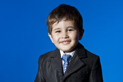 Success, cute little boy portrait over blue chroma background Stock Photos