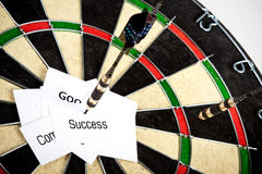 Success on dartboard Stock Images