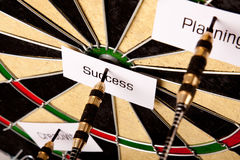 Success on dartboard Stock Photos