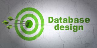 Database concept: target and Database Design on wall background. Success Database concept: arrows hitting the center of target, Green Database Design on wall Royalty Free Stock Photo