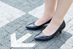 Success through decision. Arrow as concept for success through decision with female shoes on stones stock photos