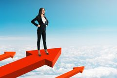 Success and development concept. Successful young woman on arrows. Blue sky background. Success and development concept. 3D Rendering royalty free stock images