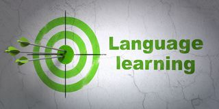 Education concept: target and Language Learning on wall background Stock Photos