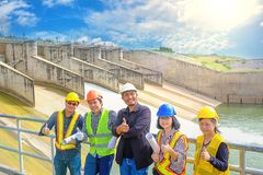 The success of the engineering team together to develop water power in dam to generate electricity. The success of the engineering team together to develop water stock photos