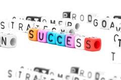 SUCCESS english alphabet cube on white background Stock Photo