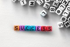 SUCCESS english alphabet cube on white paper background Stock Image