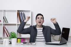 Success with enthusiasm. In the office or at home celebrating success with enthusiasm royalty free stock photo