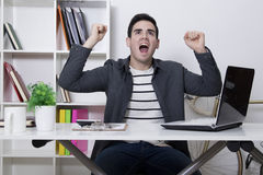 Success with enthusiasm. In the office or at home celebrating success with enthusiasm royalty free stock photography