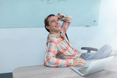 Success excited business man happy smile sitting. Office desk, young businessman laughing fun Stock Image