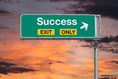 Success Exit Only Highway Sign with Sunrise Sky Royalty Free Stock Photos