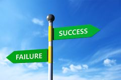 Success and failure. In arrow sign board,sky background Stock Photos
