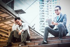 Success and failure businessmen royalty free stock photography