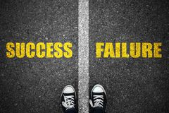 Success and failure road line on asphalt.  Stock Photography