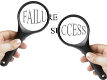 Success and Failure Text Under Magnifying Glass Stock Images