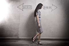 Success - Failure. Young girl against the old wall with graffiti. toned image Royalty Free Stock Image