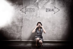 Success - Failure. Young girl against the old wall with graffiti. toned image Stock Image