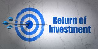 Finance concept: target and Return of Investment on wall background. Success finance concept: arrows hitting the center of target, Blue Return of Investment on Royalty Free Stock Photo