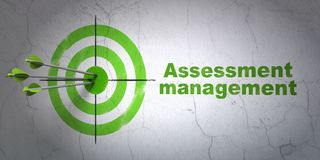 Finance concept: target and Assessment Management on wall background. Success finance concept: arrows hitting the center of target, Green Assessment Management Royalty Free Stock Photo