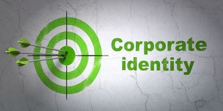 Finance concept: target and Corporate Identity on wall background. Success finance concept: arrows hitting the center of target, Green Corporate Identity on wall Royalty Free Stock Photography
