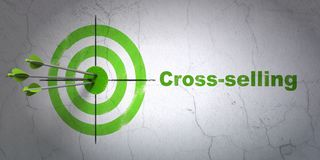 Finance concept: target and Cross-Selling on wall background. Success finance concept: arrows hitting the center of target, Green Cross-Selling on wall Stock Images