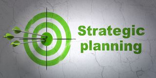 Finance concept: target and Strategic Planning on wall background. Success finance concept: arrows hitting the center of target, Green Strategic Planning on wall Royalty Free Stock Image