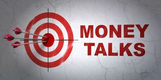 Finance concept: target and Money Talks on wall background. Success finance concept: arrows hitting the center of target, Red Money Talks on wall background, 3D Royalty Free Stock Image
