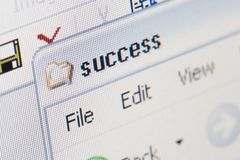 Success folder. Close up shot of a laptop screen, shallow DOF, focus on first s letter royalty free stock images
