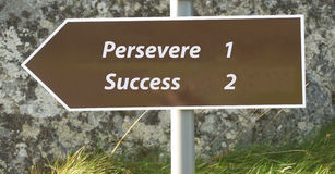 Success follows perseverance. Stock Photos