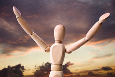 Success and Freedom. Dummy figure expressing freedom and success with clouds on the background royalty free stock image