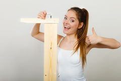 Success ful woman assembling furniture. DIY. Royalty Free Stock Photo