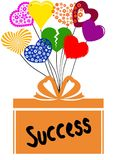 SUCCESS on gift box with multicoloured hearts Royalty Free Stock Images