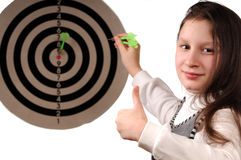 Success. Girl hitting the darts target Royalty Free Stock Photography