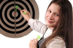 Success. Girl hitting the darts target stock images