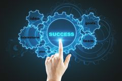 Success and goals concept. Close up of hand pointing at glowing blue digital cogs on black background. Success and goals concept. 3D Rendering royalty free illustration