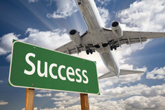 Success Green Road Sign and Airplane Above Royalty Free Stock Images
